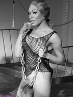 Fetish bampw TS Mia Isabella in lusty fishnet playing with chains.