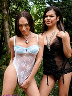 In the woods with carmen Pleasant TS Mia Misabella posing in the woods with Carmen.
