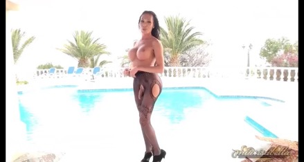 Mia stroking her huge throbbing dong by the poolside.