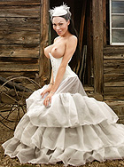 Mia white. Elegant Mia posing in a delicate wedding dress